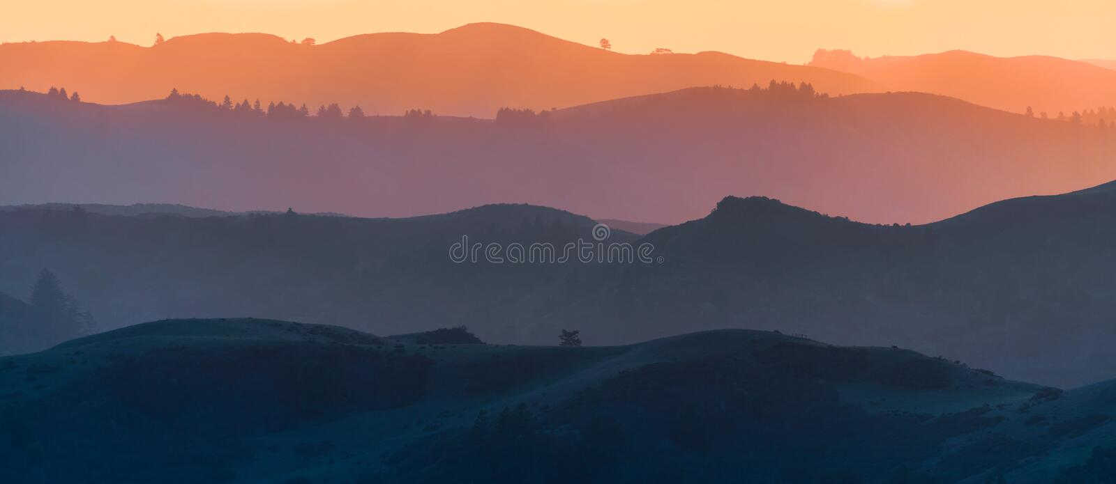 Sunset view of hills and valleys, each layer colored differently;  Santa Cruz mountains ; San Francisco bay area, California royalty free stock photos
