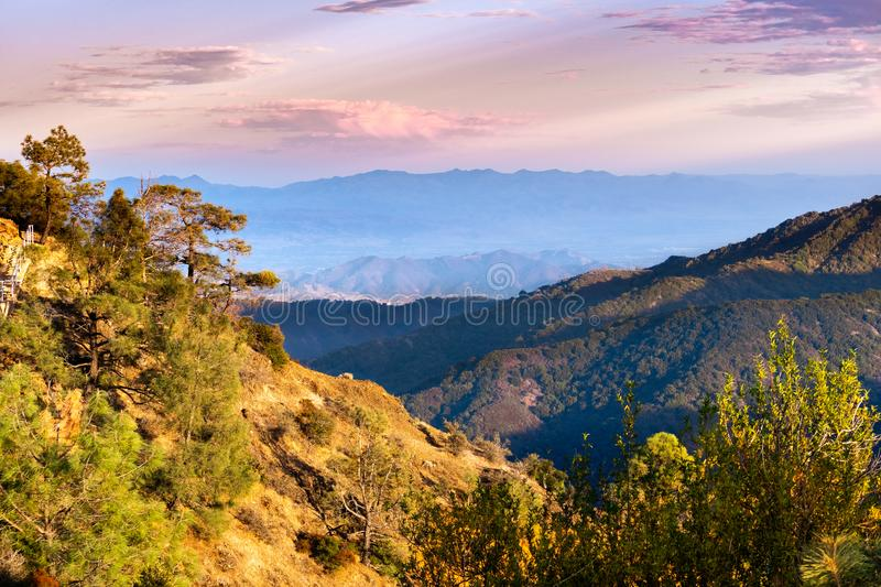 Sunset view of hills and valleys in the Santa Cruz mountains; South Clara Valley and Diablo mountain range visible in the. Background stock photos