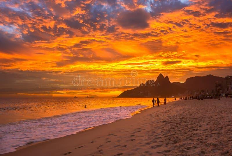 Sunset view of Ipanema beach and mountain Dois Irmao (Two Brother) in Rio de Janeiro stock photo