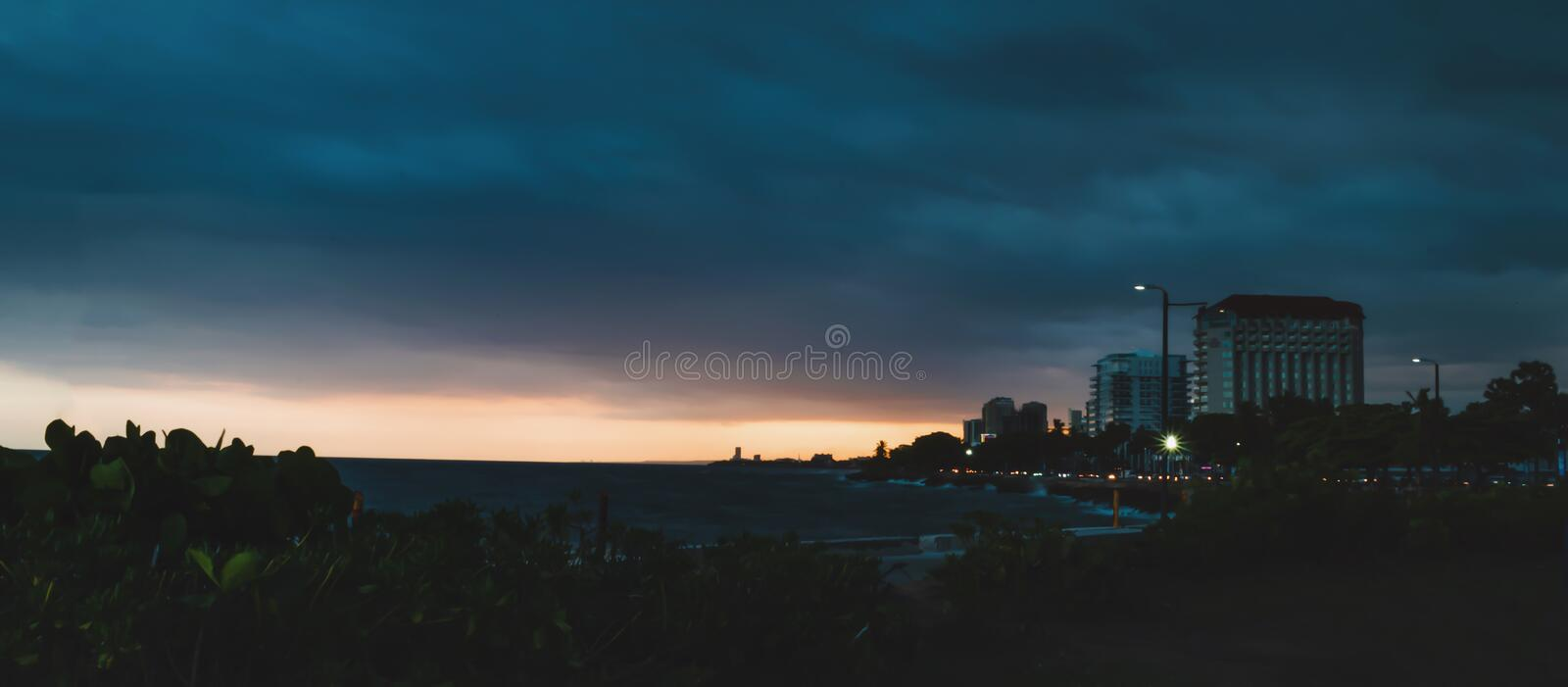 Sunset view at Juan Baron Square Santo Domingo, Dominican Republic with a tropical blue sea and clear sky and warm rays royalty free stock image