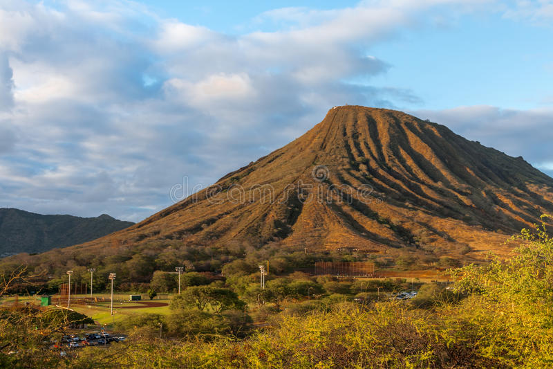 Sunset view of Koko Crater on Oahu, Hawaii. Sunset drive on the southeast side of Oahu, Hawii captures the beauty of the setting sun on Koko Crater, also showing royalty free stock image