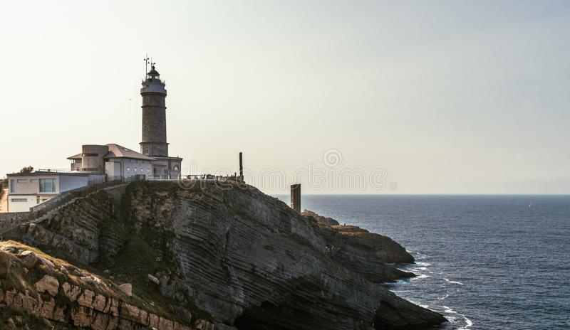 Sunset view of a lighthouse in Santander, Northern Spain stock image