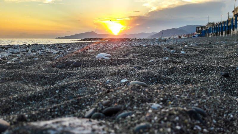Sunset on ligurian beach stock photos