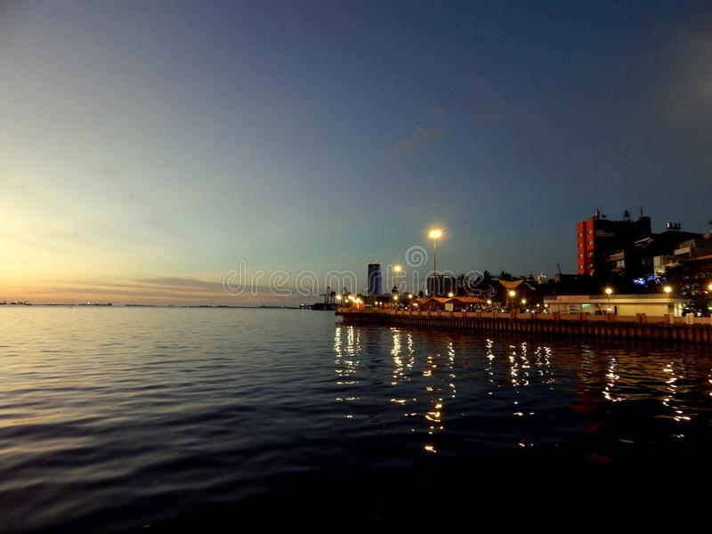 The sunset view of water front city of Makassar, Indonesia stock photo