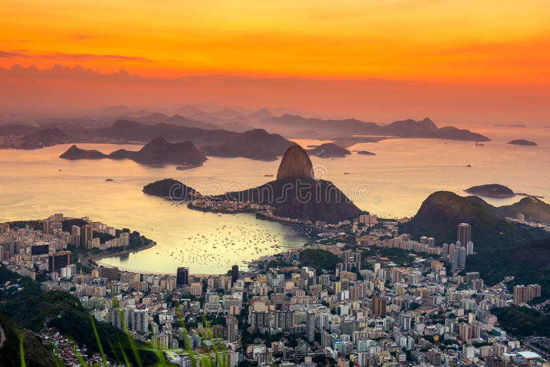 Sunset view of mountain Sugar Loaf and Botafogo in Rio de Janeiro. Brazil royalty free stock images