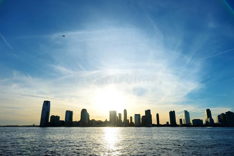 Sunset view of New Jersey City skyline as seen from Battery Park City, New York stock image