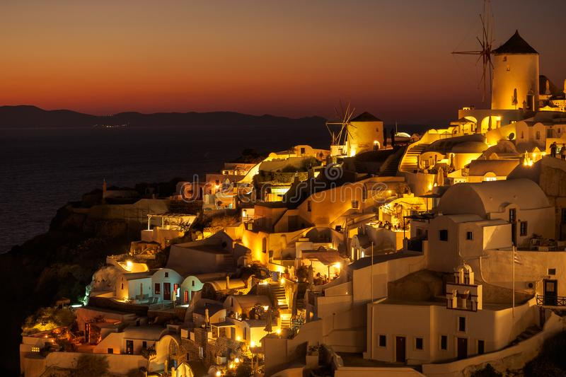 Sunset view of Oia town on Santorini in Greece royalty free stock image