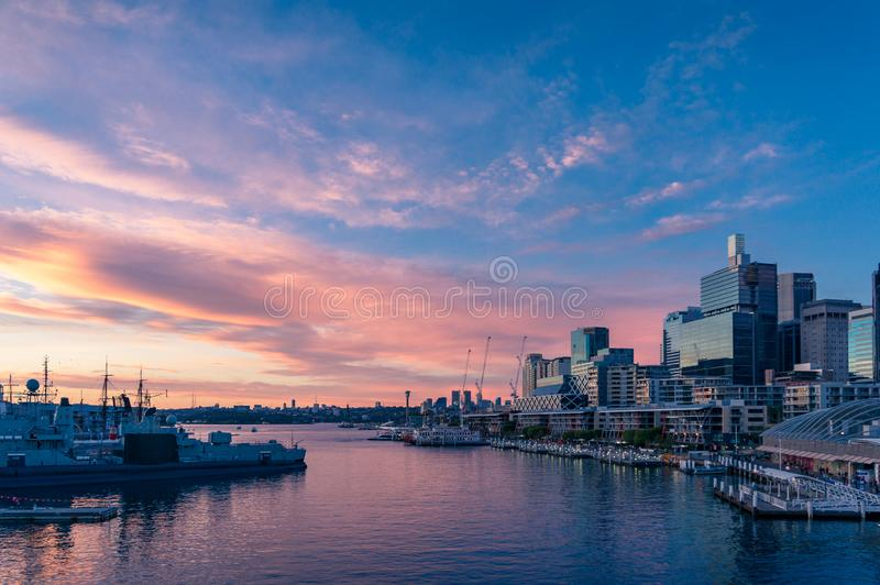 Sunset view over Sydney Harbour and business office buildings royalty free stock photography