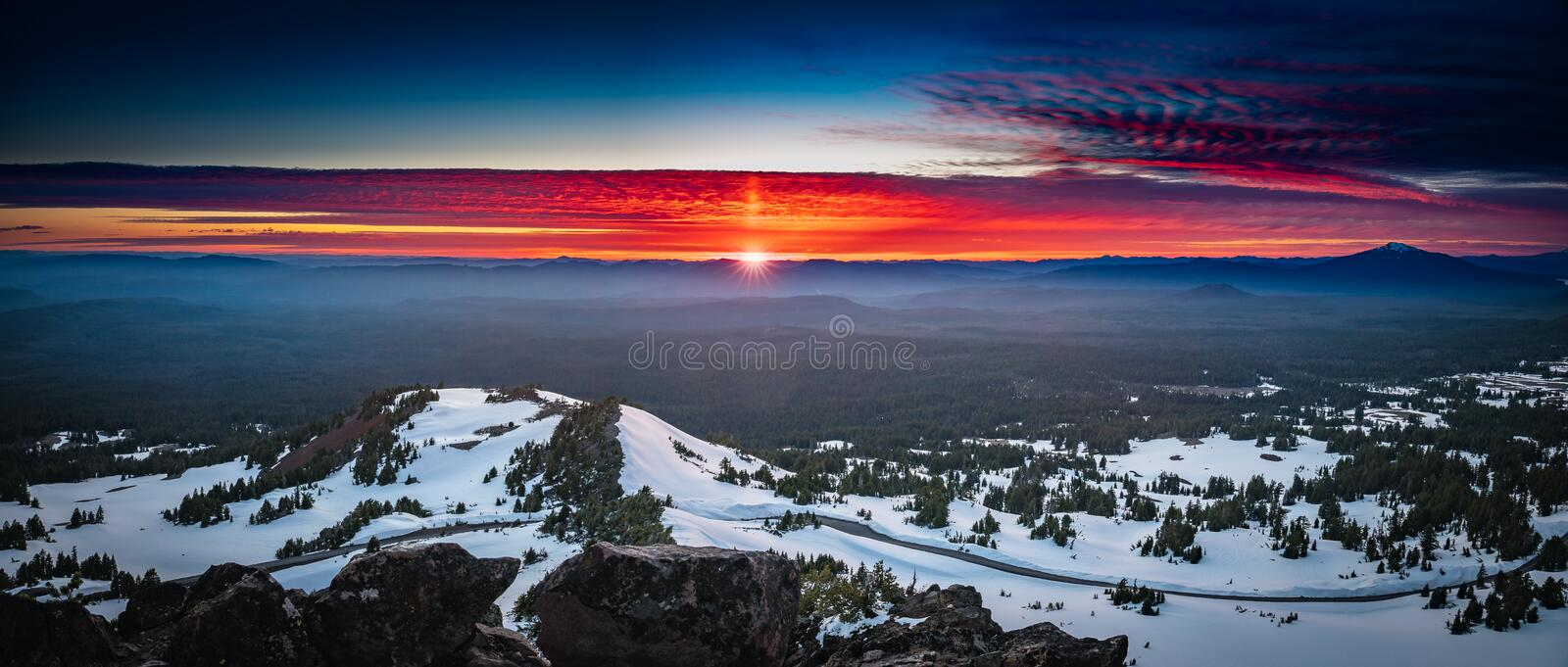 The epic sunset at Crater Lake. This is a sunset view from a peak of Crater Lake National Park, Oregon, USA stock photos