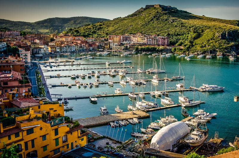 Porto Ercole village and harbor in a sea bay. Aerial view, Argentario, Tuscany, Italy. royalty free stock photos