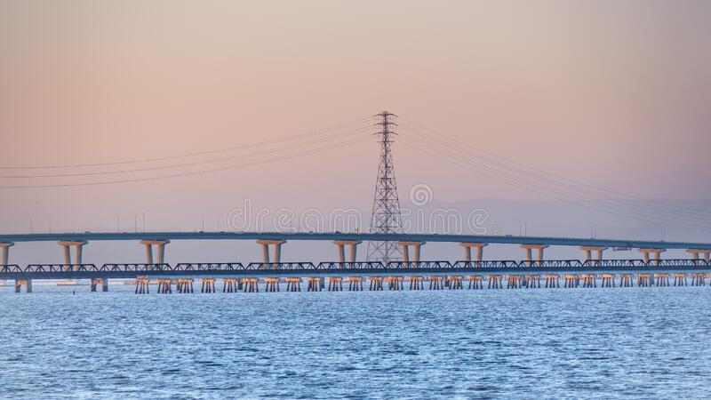 Sunset view of the raised part of Dumbarton Bridge and an old railroad track, connecting Fremont to Menlo Park, San Francisco bay royalty free stock photos