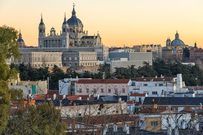 Sunset view of Royal Palace and Almudena Cathedral in City of Madrid, Spain. MADRID, SPAIN - JANUARY 21, 2018: Sunset view of Royal Palace and Almudena Cathedral royalty free stock photos