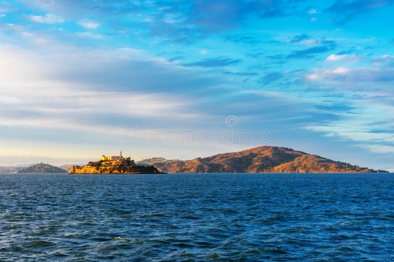 Sunset view of scenic San Francisco Bay kustline from the pier in San Francisco in the direction of Tiburon, Alcatraz and Angel arkivfoton