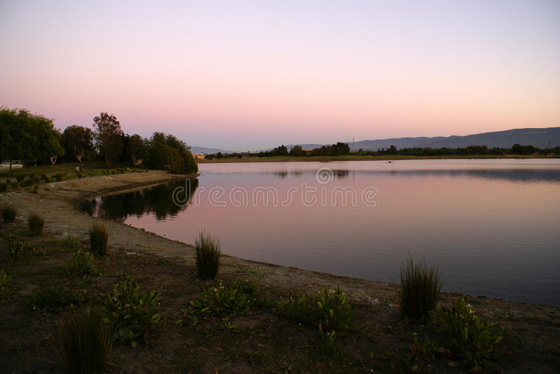 Sunset view of Shoreline Park Lake in evenings, Mountain View, California, USA,. Popular destination for residents and visitors with recreation facilities royalty free stock photo