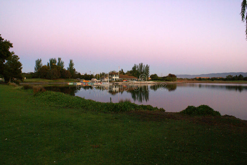 Sunset view of Shoreline Park Lake in evenings, Mountain View, California, USA. Popular destination for residents and visitors with recreation facilities royalty free stock images