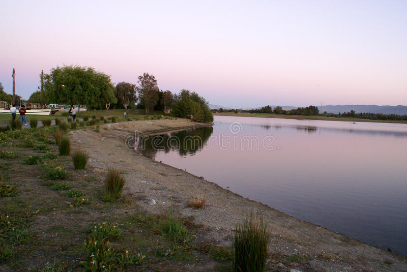 Sunset view of Shoreline Park Lake in evenings, Mountain View, California, USA. Popular destination for residents and visitors with recreation facilities royalty free stock image