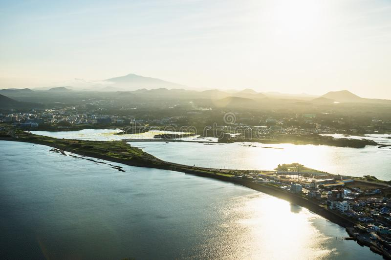 Sunset view to Hallasan peak from Ilchulbong peak to Seongsan, Jeju Island, South Korea stock image