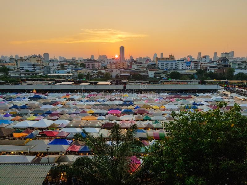 Sunset view train night market, here is a big second-hand flea street food and bars. Sunset view train night market      second-hand   food bars bazaar   bangkok stock images