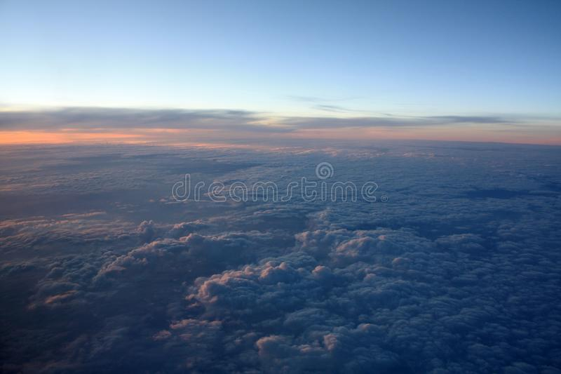 Sunset photo from the flying plane stock photos