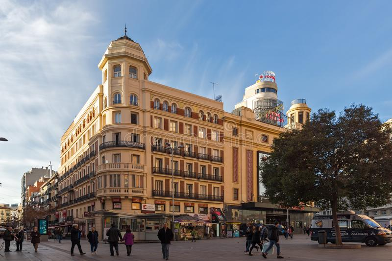 Sunset view of walking people at Callao Square Plaza del Callao in City of Madrid, Spain royalty free stock image
