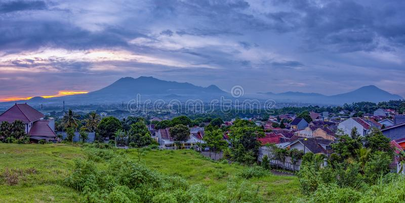 Sunset with views of Malang Java city of Indonesia. Sunset Colorful sky with views of Malang Java city of Indonesia stock photo