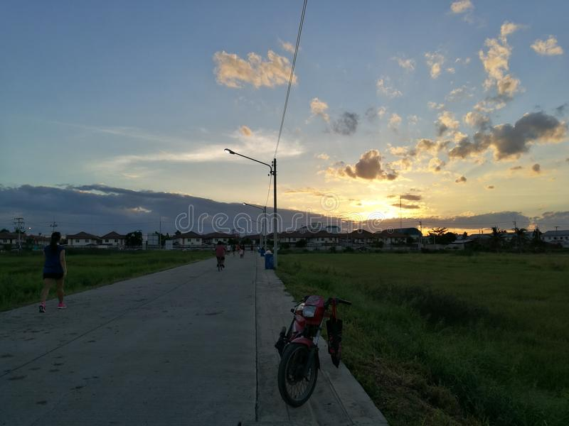 Sunset in village, Bangkok Thailand stock photos