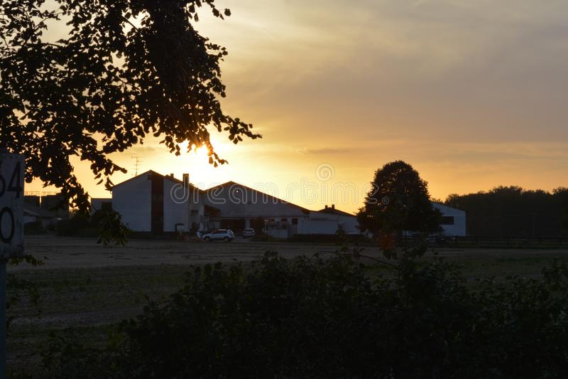 sunset in village in Germany with empty railways on sunset sky background stock image
