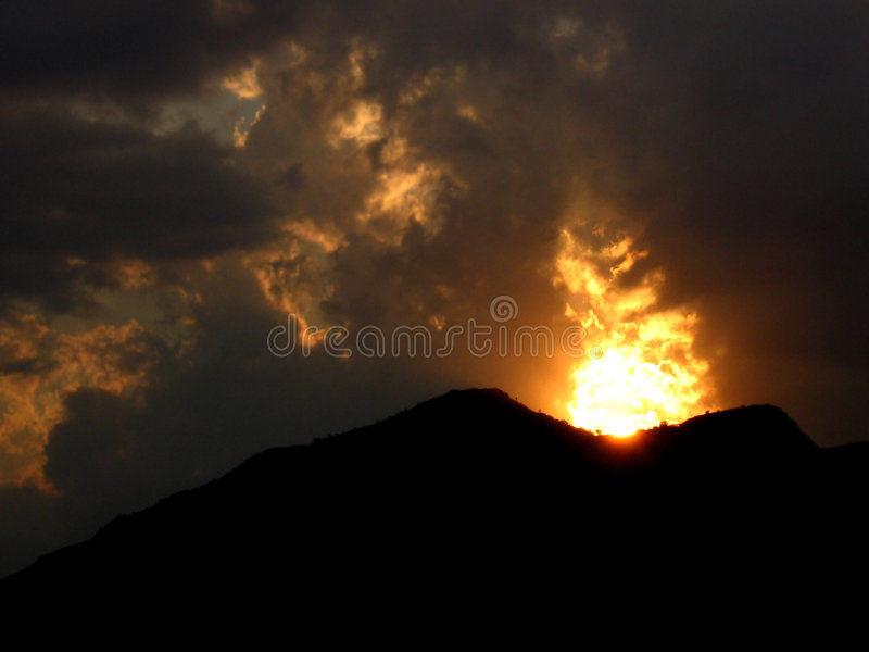 Sunset Volcano. A sunset appears like a volcano in India making it a beautiful spectacle stock photo