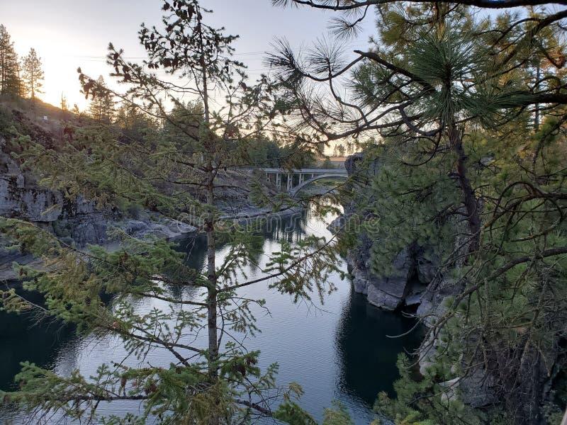 Sunset walk through the park. Waterrocks, bridge royalty free stock photo