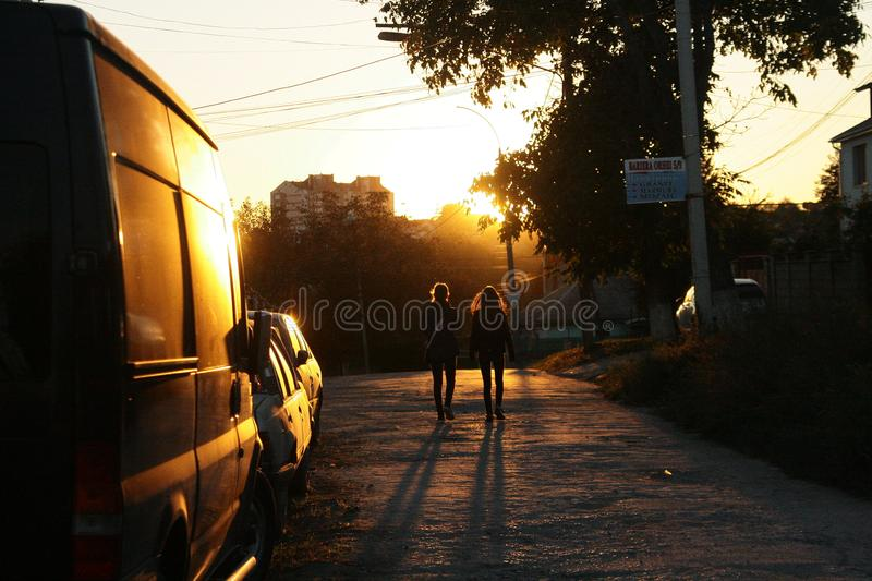 sunset walking couple contrast street urban stock image