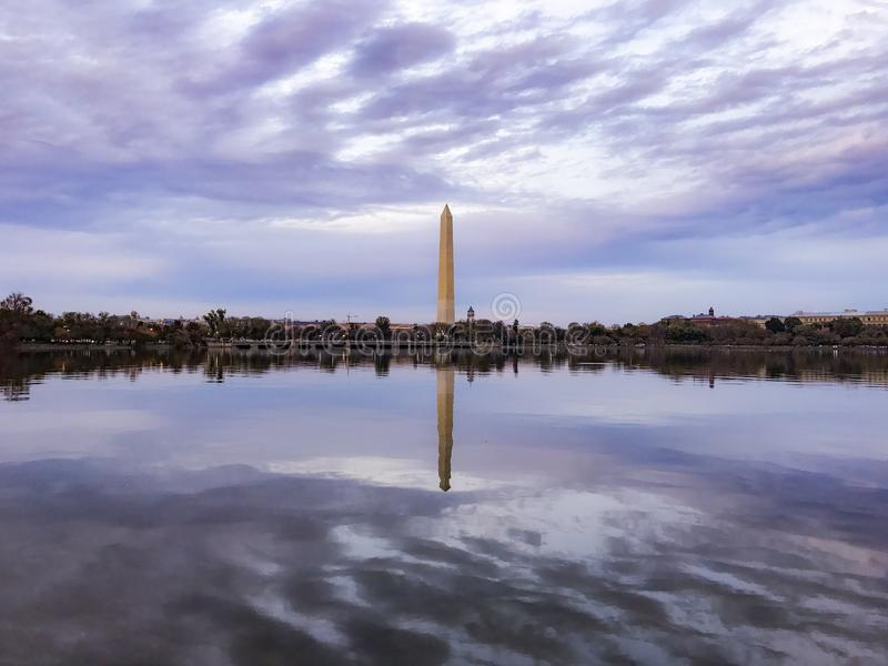Sunset. Washington monument fall red leaves water pool reflections beautiful fun cold colorful walking tour tourist lovely falling cloudy clouds weather pretty royalty free stock photography