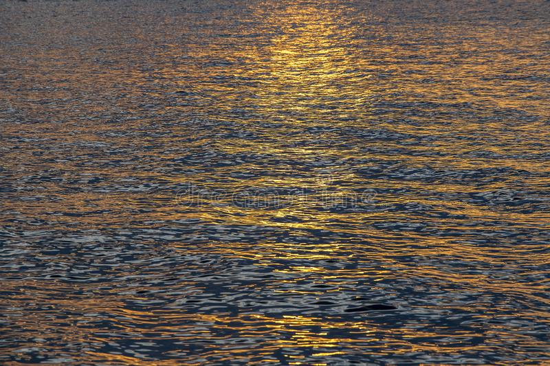 Sunset water background, surface water in the sunset time, Thailand. Nature concept. Golden sunset texture on the water, surface stock photo