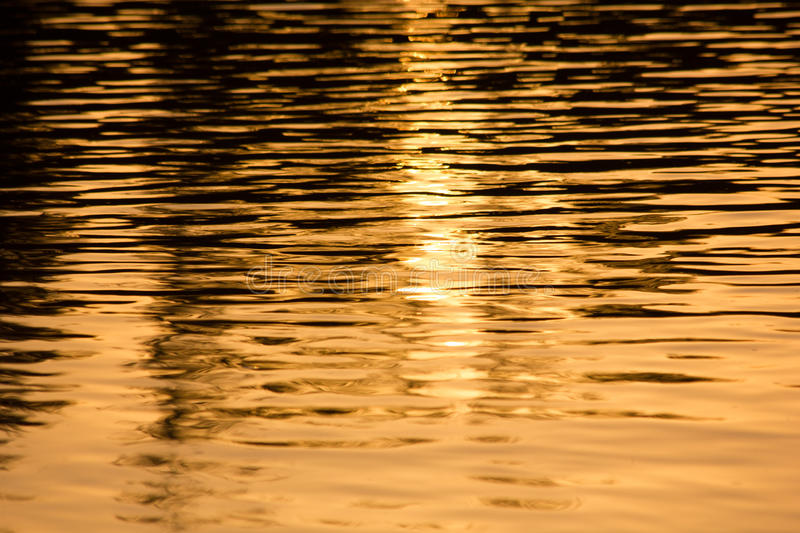 Sunset on a water stock photos