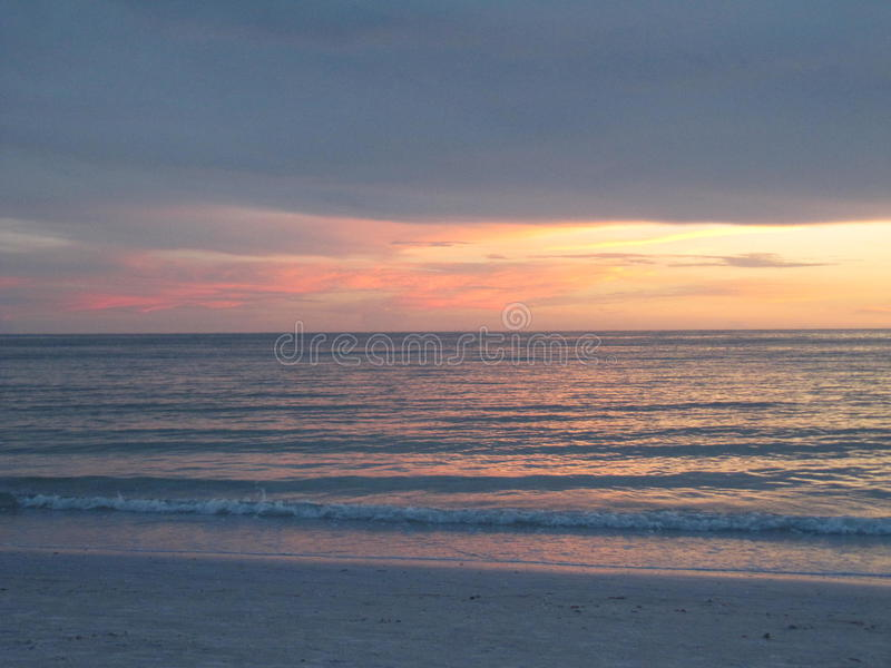 Sunset on the Water in Lido Beach, Floridaa royalty free stock photo