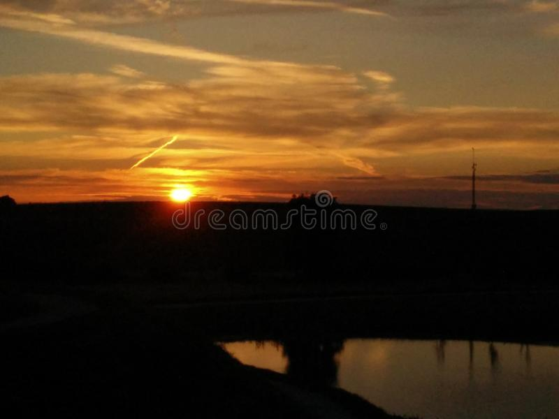 Sunset by the water royalty free stock image