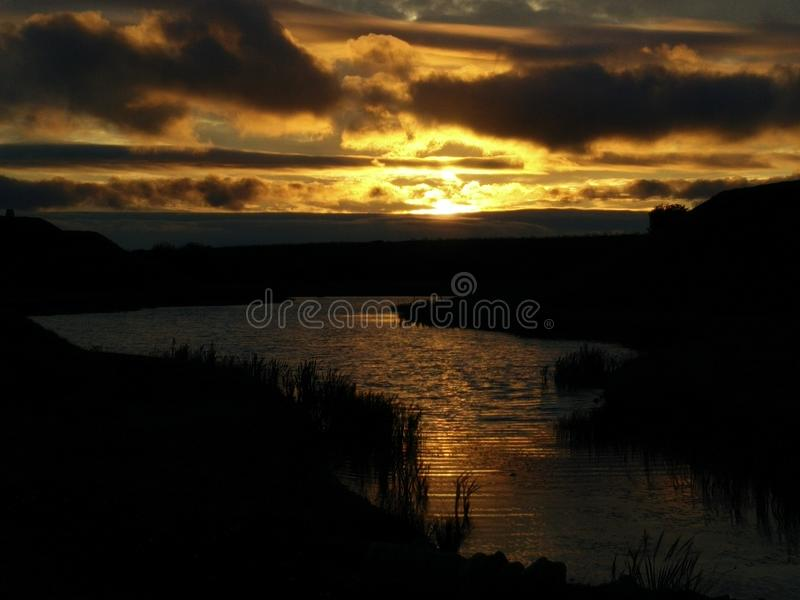 Sunset by the water royalty free stock photography