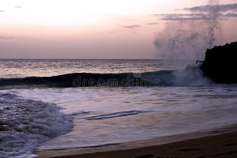 Sunset Santo Domingo and wave royalty free stock image
