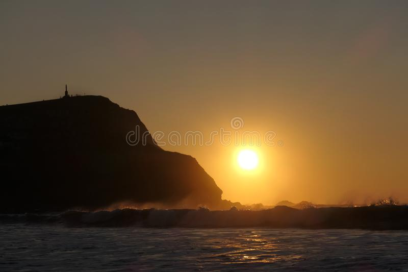 Sunset and waves at Borth Cliffs. A beautiful sunset with waves at Borth Cliffs near to Aberystwyth, Wales stock images