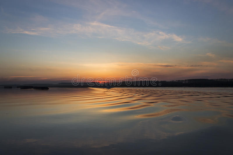 Sunset with waves stock photography