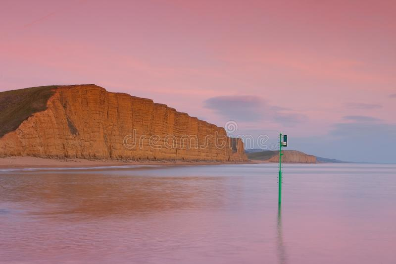 Sunset in West Bay, Dorset, England. The area is part of the Jurassic Coast, a World Heritage Site royalty free stock photography