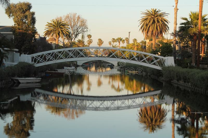 Sunset White bridge with reflection on the river stock photo