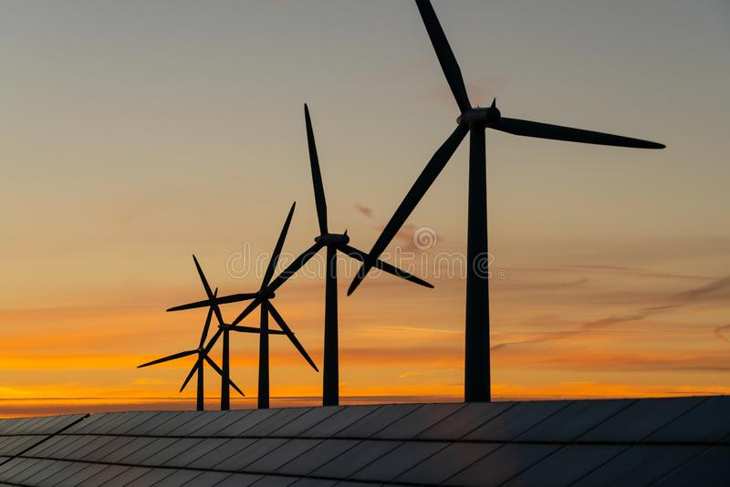 Wind turbine energy generaters on wind farm royalty free stock photos