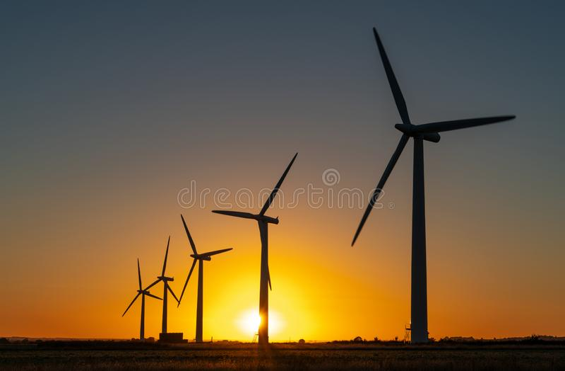 Wind turbine energy generaters on wind farm royalty free stock photo