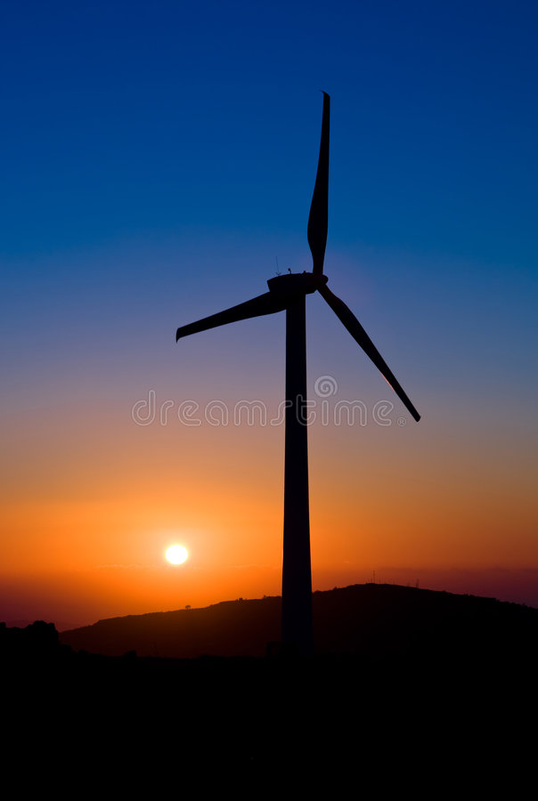 Sunset with windmills royalty free stock images