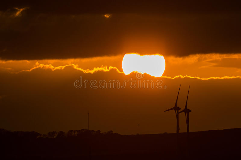 Sunset with windmills royalty free stock photos