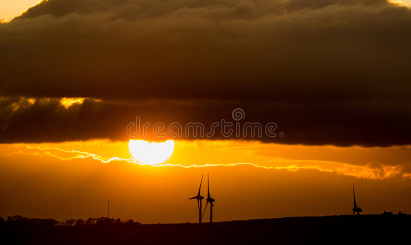 Sunset with windmills stock photos