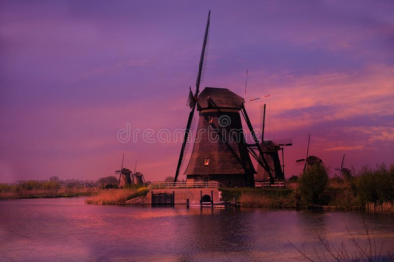 Sunset at the windmills in Kinderdijk in Netherlands stock images