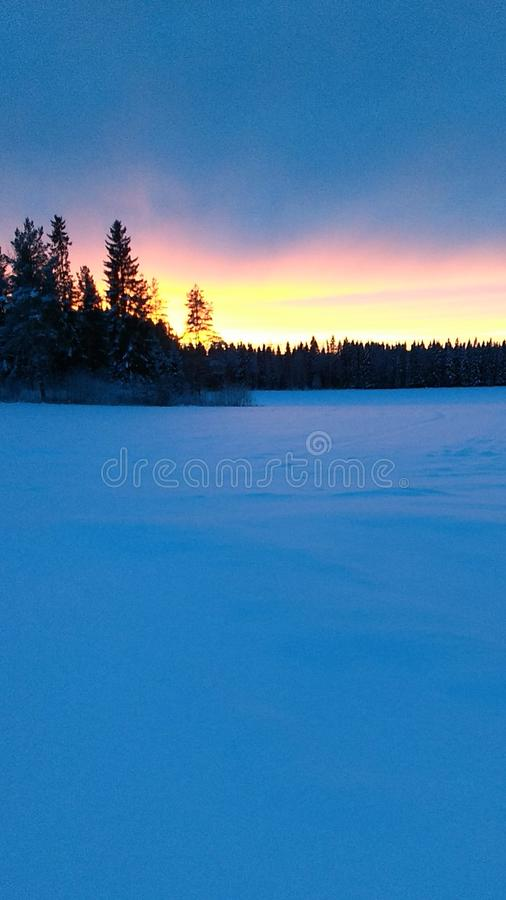 The sunset at wintertime stock photography