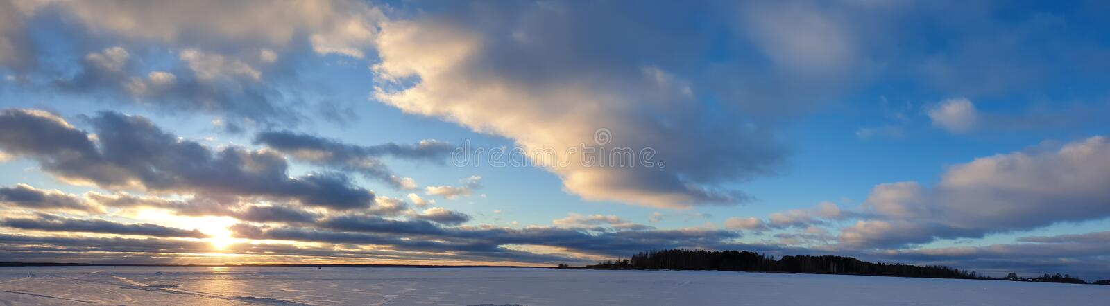 Sunset in winter. The landscape is winter panned. Lake in the woods in winter royalty free stock images