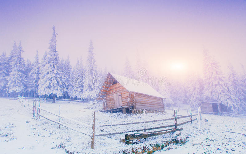 Sunset in the winter mountains and fantastic chalet stock photos
